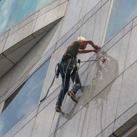 Man cleaning high level windows